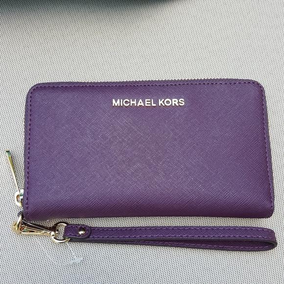 37905546e33ad3 Michael Kors Bags   Nwt Lg Wallet Phone Case Damson Mk   Poshmark